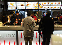 Customer is ordering his meal at the counter of McDonald in Tokyo, Japan