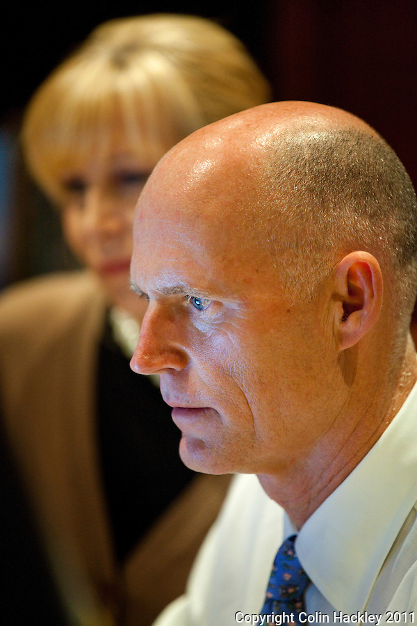 TALLAHASSEE, FLA. 1/20/11-SCOTT12011HACKLEY04-Gov. Rick Scott responds to questions via computer during a Twitter town hall meeting as his wife Ann looks over his shoulder Thursday at the Governor's Mansion in Tallahassee..COLIN HACKLEY PHOTO