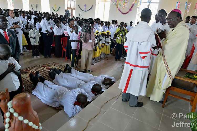 Archbishop Paulino Lukudu Loro of Juba, South Sudan, presides over an October 7, 2012, ordination service in the Holy Rosary Church in Juba. Three deacons were ordained.