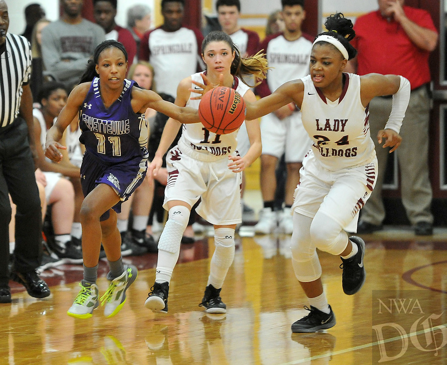 NWA Democrat-Gazette/MICHAEL WOODS &bull; @NWAMICHAELW<br /> Fayetteville's Pink Jones (11) and Springdale's Chasidee Owens (24) go after a loose ball Friday, January 15, 2016 during their game at Springdale High School.