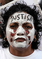 A woman protests against the violence and assassinated of its son during World Social Forum in Belém on January 27, 2009.