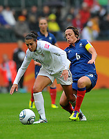 Carli Lloyd (l) of team USA and Sandrine Soubeyrand of team France during the FIFA Women's World Cup at the FIFA Stadium in Moenchengladbach, Germany on July 13th, 2011.