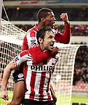 Nederland, Eindhoven, 30 januari  2013.KNVB Beker.Seizoen 2012/2013.PSV-Feyenoord.Aanvoerder Mark van Bommel met Georginio Wijnaldum op zijn rug van PSV juicht na het scoren van de 2-1
