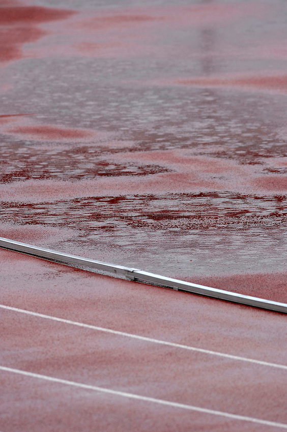 Photo: Richard Lane..VISA Paralympic World Cup 2007. Athletics. 13/05/2007. .Rain falls on the running track at the Manchester Regional Arena.