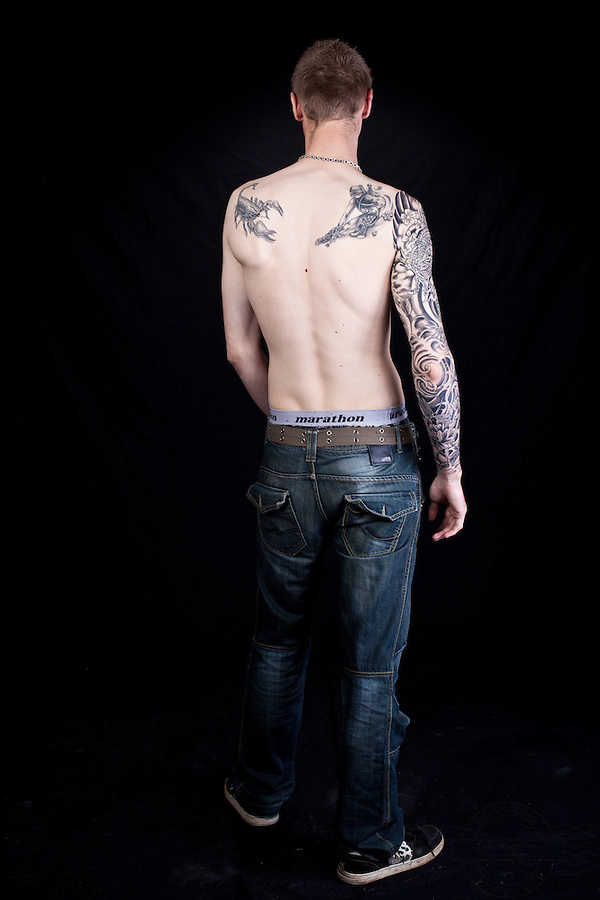 Young danish man with fantastic black and grey japanese tattoo covering the entire right arm. From the tattoo, convention, Kolding, Denmark