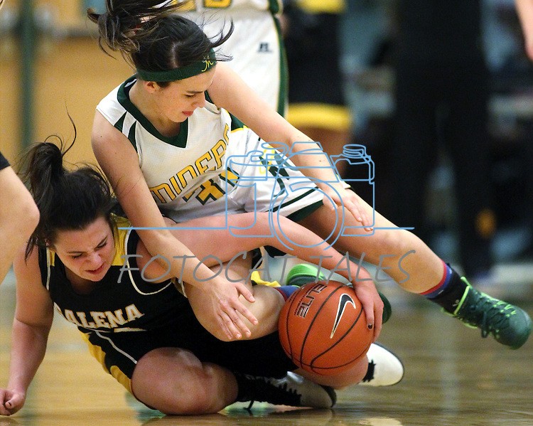 Manogue's Hanna Bingham and Galena's Paige Brown wrestle over a loose ball at Manogue High School in Reno, Nev., on Tuesday, Feb. 11, 2014. Manogue won 51-29.<br /> Photo by Cathleen Allison