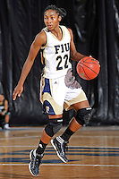 11 November 2011:  FIU's Jerica Coley (22) handles the ball in the second half as the FIU Golden Panthers defeated the Jacksonville University Dolphins, 63-37, at the U.S. Century Bank Arena in Miami, Florida.