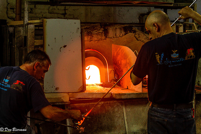 Venice, Italy; Murano, the glass-blowing island. Glass factory workers.