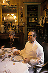 French chef portrait Paul Bocuse in Lyon, France with wife in their private apartment, having lunch. 1980s