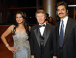 From left: Dr. Manju Chandna, County Judge Ed Emmett and Dr. Harish Chandna at the Indian Film Festival Celebrity Gala at the InterContinental Hotel Saturday evening Sept. 26,2009. (Dave Rossman/For the Chronicle)
