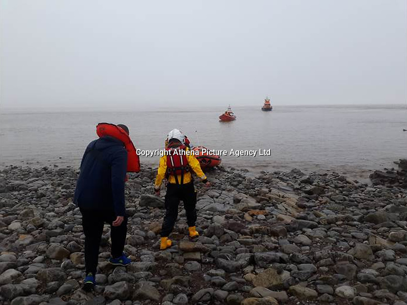 PLEASE BYLINE RNLI/PENARTH<br /> Pictured: RNLI volunteers rescue the stranded Rusiian sailors from Flat Holm island<br /> Re: Three sailors left cargo ship Alana Evita, moored two miles off Minehead on Tuesday night. The sailors left the ship in the evening on a rigid inflatable boat and headed for Barry in south Wales. They were reported overdue at 7am on Wednesday morning. The three had attempted to make their way back from Barry to Minehead on the rigid inflatable boat but got lost in foggy conditions in the channel.<br /> Minehead RNLI's Atlantic class lifeboat and Barry Dock's Trent all-weather lifeboat were launched just after 7am on Wednesday morning to assist in the search. As the search continued two lifeboats from Penarth RNLI, the Atlantic 85 and D-class lifeboat, along with Ilfracombe RNLI's Shannon class lifeboat also launched to assist at around 8am. All five lifeboats lifeboats carried out detailed searches along their coastlines.<br /> The sailors were found safe but very cold on Flat Holm Island at around 8:30am the same day by Penarth RNLI volunteers. After being assessed by the RNLI volunteers the Coastguard 187 helicopter landed on the island to further assess the casualties but it was decided they were well enough to return to land by lifeboat.<br /> All lifeboats have now been stood down and are returning to their relative stations.