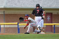Auburn Doubledays first baseman Adalberto Carrillo (8) stretches for a throw as Peyton Burdick (7) runs through the bag during a NY-Penn League game against the Batavia Muckdogs on June 19, 2019 at Dwyer Stadium in Batavia, New York.  Batavia defeated Auburn 5-4 in eleven innings in the completion of a game originally started on June 15th that was postponed due to inclement weather.  (Mike Janes/Four Seam Images)