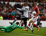 Jordan Smith of Nottingham Forest frustrates Leon Clarke of Sheffield Utd during the Championship match at the City Ground Stadium, Nottingham. Picture date 30th September 2017. Picture credit should read: Simon Bellis/Sportimage