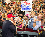MOBILE, AL- AUGUST 21: U.S. Republican presidential candidate Donald Trump greets supporters after his rally at Ladd-Peebles Stadium in Mobile, Alabama on August 21, 2015 . The Donald Trump campaign moved tonight's rally to a larger stadium to accommodate demand. (Photo by Mark Wallheiser/Getty Images)