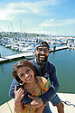 Catching the Bangor Sun's rays are  Rubel Rahman and Aysha Khan from Bangladesh now living and working in Bangor, County Down, Northern Ireland, Monday, June 10, 2019.  (Photo by Paul McErlane for Belfast Telegraph)