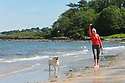 Catching the Sun's rays are Grainne Evans with Sally (the dog) at Helens Bay, County Down, Northern Ireland, Monday, June 10, 2019.  (Photo by Paul McErlane for Belfast Telegraph)
