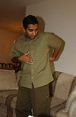 Linthicum, MD - October 8, 2002 -- Rupinder Oberoi, the victim in an unexplained shooting on September 14, 2002 in the Hillandale Shopping Center in Silver Spring, MD describes his gunshot wounds.<br /> Credit: Ron Sachs / CNP<br /> (RESTRICTION: NO New York or New Jersey Newspapers or newspapers within a 75 mile radius of New York City)