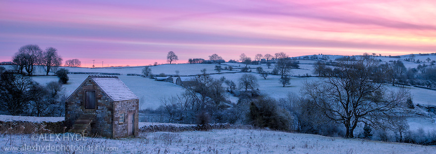 Stone barn at dawn, Bonsall village, Peak District,  Derbyshire, UK. February.
