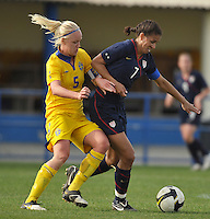 US Women's National Team defender and captain Shannon Boxx is challenged by a Swedish defender in a game in Ferreiras, Portugal on March 1, 2010 durng the Algarve Cup.
