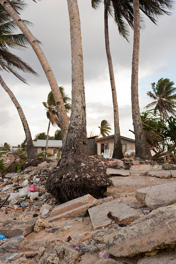 A cemetery that has been badly hit by high tides and storm surges crumbles into the ocean beach on Majuro Atoll, July, 2009.