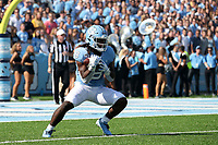 CHAPEL HILL, NC - SEPTEMBER 21: Michael Carter #8 of the University of North Carolina returns a kickoff during a game between Appalachian State University and University of North Carolina at Kenan Memorial Stadium on September 21, 2019 in Chapel Hill, North Carolina.
