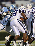 16 September 2006: Furman's Cedrick Gipson (22) is tackled by North Carolina's Kyndraus Guy (74). The University of North Carolina Tarheels defeated the Furman University Paladins 45-42 at Kenan Stadium in Chapel Hill, North Carolina in an NCAA College Football game.
