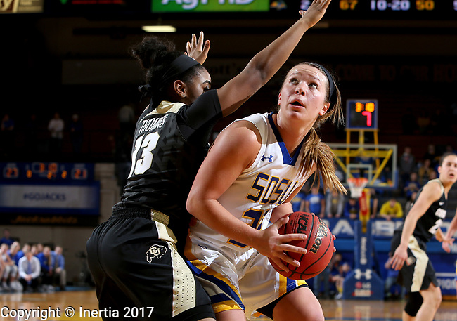 BROOKINGS, SD - MARCH 19:  Sydney Palmer #32 from South Dakota State looks to the basket past Brecca Thomas #13 from Colorado during their second round WNIT game at Frost Arena March 19, 2017 in Brookings, South Dakota. (Photo by Dave Eggen/Inertia)