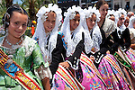 Young girls dressed with traditional attires at Hogueras de San Juan, Fogueres de Sant Joan festival..Alicante City, Costa Blanca, Spain, Europe.