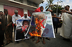 Palestinian supporters of the Democratic Front for the Liberation of Palestine (DFLP) burn pictures depicting Israeli Prime Minister Benjamin Netanyahu and Avigdor Lieberman, head of Yisrael Beitenu party, during a protest to solidarity with prisoners from Israeli jails, in Khan Younis in the southern Gaza Strip, on September 19, 2019. Photo by Ashraf Amra