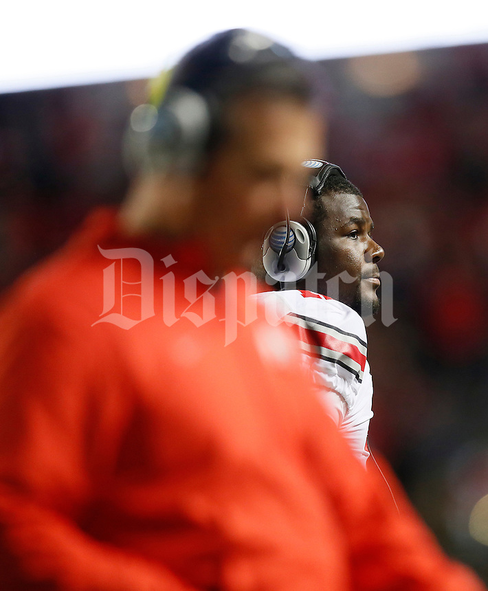 Ohio State Buckeyes quarterback Cardale Jones (12) and Ohio State Buckeyes head coach Urban Meyer head back to the sideline after a stop in play during the college football game between the Rutgers Scarlet Knights and the Ohio State Buckeyes at High Point Solutions Stadium in Piscataway, NJ, Saturday night, October 24, 2015. The Ohio State Buckeyes defeated the Rutgers Scarlet Knights 49 - 7. (The Columbus Dispatch / Eamon Queeney)