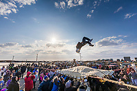 Under the midnight sun, the blanket toss is enjoyed by all during Nalukataq in Utqiagvik (Barrow) Alaska in Alaska's Arctic.
