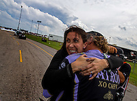 Sept. 1, 2014; Clermont, IN, USA; NHRA funny car driver Alexis DeJoria (left) celebrates with husband Jesse James after winning the US Nationals at Lucas Oil Raceway. Mandatory Credit: Mark J. Rebilas-USA TODAY Sports