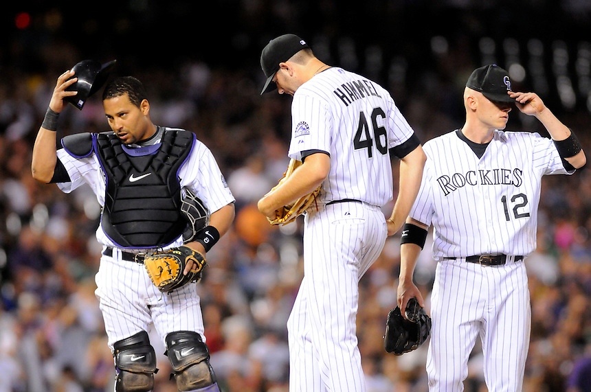 September 9, 2009: Rockies starting pitcher Jason Hammel did not factor in the decision despite pitching 7 1/3 innings while giving up only 2 runs on 3 hits and striking out 8 during a regular season game between the Cincinnati Reds and the Colorado Rockies at Coors Field in Denver, Colorado. Here, Hammel, catcher Yorvit Torrealba, and shortstop Clint Barmes wait on the mound for manager Jim Tracy as Hammel is relieved in the 8th inning. The Rockies beat the Reds 4-3 with a come-from-behind 2-RBI walkoff single in the 9th inning. *****For editorial use only*****