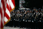 Thousands of police officers and military turned out for the funeral of James McNaughton, the first NYPD officer killed in the war in Iraq. NYPD units from all over the city lined the streets as the casket was driven from the church to the cemetery.
