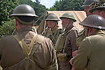 Living History event. Home Guard soldiers discuss their battle plans.