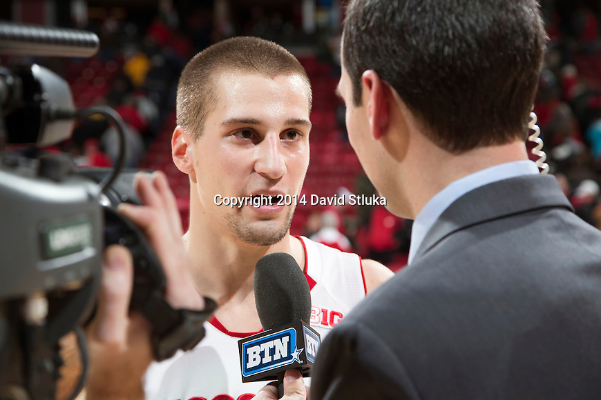 Wisconsin Badgers Ben Brust (1) is interviewed by Big Ten Network reporter Mike Kelley after an NCAA college basketball game against the Iowa Hawkeyes Sunday, January 5, 2014 in Madison, Wis. The Badgers won 75-71. (Photo by David Stluka)
