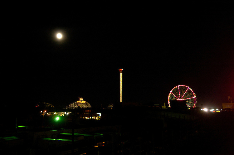 "Moon rise over the ferris wheel know as the ""Wonder Wheel""  and the famous cyclone roller coster at Coney Island during the 2004 Republican National Convention."