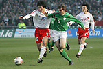 Dublin Ireland, Ireland's No 8 Kevin Kilbane holding off China's No 16 Ji Mingyi during the friendly international soccer match in Lansdowne Road, Stadium, Dublin, Irelande, 29/3/05.Photo AFP/NEWSFILE/FRAN CAFFREY..(Photo credit should read  AFP Photo FRAN CAFFREY/NEWSFILE)...This Picture has been sent you under the condtions enclosed by:.Newsfile Ltd..the Studio,.Millmount Abbey,.Drogheda,.Co Meath..Ireland..Tel: +353(0)41-9871240.Fax: +353(0)41-9871260.GSM: +353(0)86-2500958.email: pictures@newsfile.ie.www.newsfile.ie.FTP: 193.120.102.198..This picture is from Fran Caffrey@newsfile.ie
