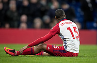 Daniel Sturridge of WBA holds his leg injured before coming off in the 3rd minute during the Premier League match between Chelsea and West Bromwich Albion at Stamford Bridge, London, England on 12 February 2018. Photo by Andy Rowland.