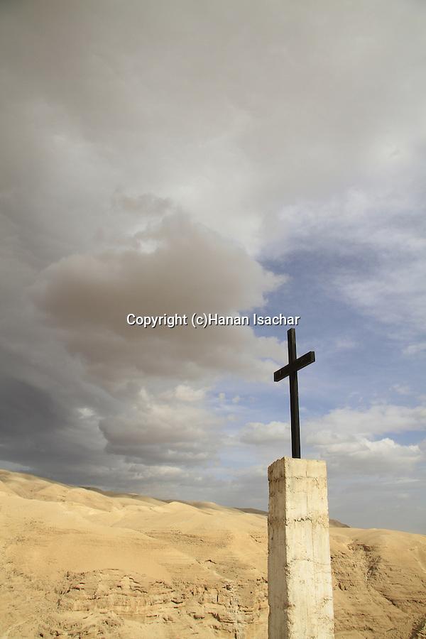 Judean Desert, a cross on the road to the Greek Orthodox St. George Monastery in Wadi Qelt