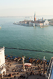 ITALY, Venice.  An elevated view of Doge's Palace on the left and the Columns of the Lion and San Teodoro on the right at the Piazza San Marco. The island of San Giorgio Maggiore can be seen in the distance, dominated by the tower and dome of the Church of San Giorgio Maggiore. The view is from the St. Mark's Campanile, the bell tower on St. Mark's Square.
