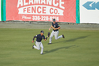 Pulaski Yankees center fielder Madison Santos (58) makes a catch in front of right fielder Jake Pries (36) during the game against the Burlington Royals at Burlington Athletic Stadium on August 25, 2019 in Burlington, North Carolina. The Yankees defeated the Royals 3-0. (Brian Westerholt/Four Seam Images)