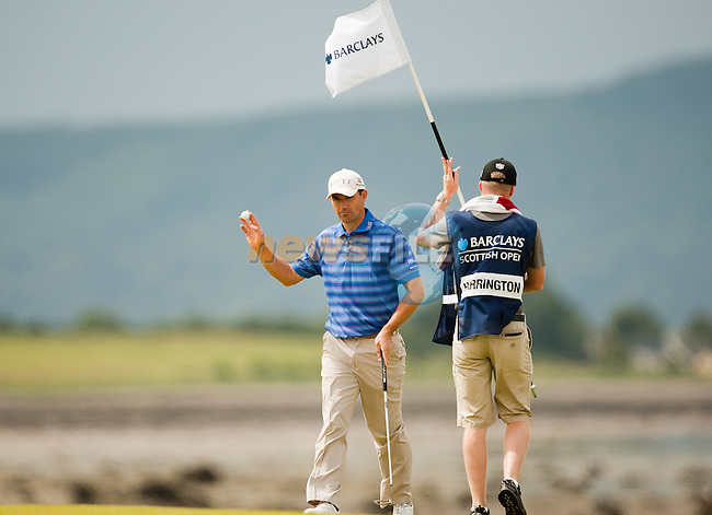 Padraig Harrington  acknowledges the galleries after a birdie putt during the final round  of the Barclays Scottish Open, played over the links at Castle Stuart, Inverness, Scotland from 7th to 10th July 2011:  Picture Stuart Adams /www.golffile.ie 10th July 2011
