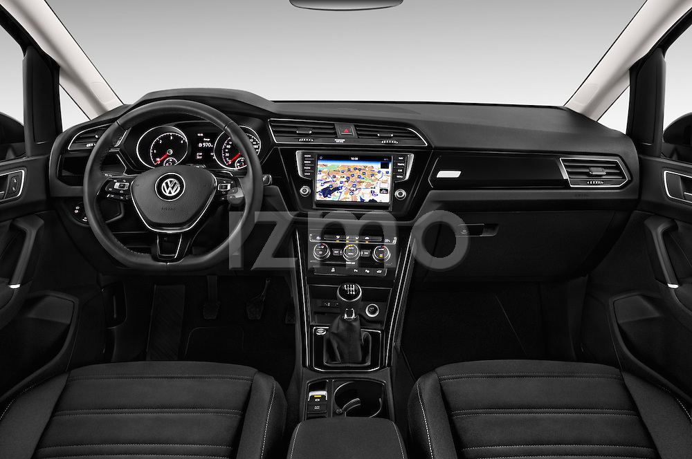 Stock photo of straight dashboard view of 2016 Volkswagen Touran Highline 5 Door Mini Mpv Dashboard