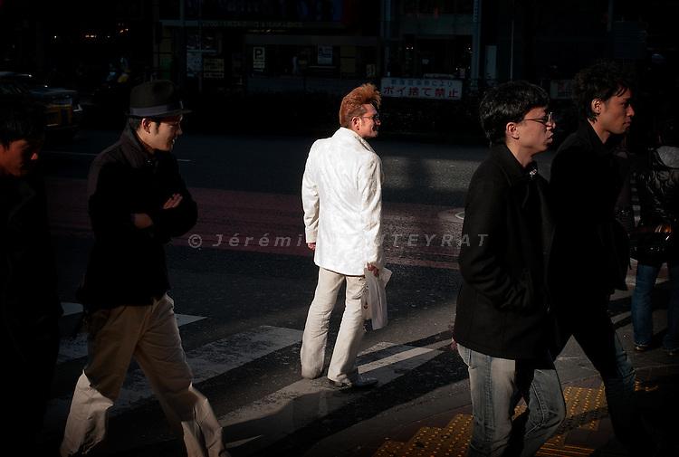 Tokyo, Shinjuku. Rockabily with a white suit on the street.