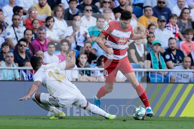Carlos Henrique Casimiro of Real Madrid and Antonio Jose Rodriguez Diaz of Granada CF during La Liga match between Real Madrid and Granada CF at Santiago Bernabeu Stadium in Madrid, Spain. October 05, 2019. (ALTERPHOTOS/A. Perez Meca)