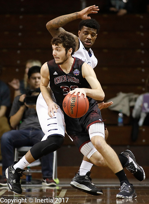 SIOUX FALLS, SD: MARCH 22: Corey Silverstrom #33 of Chico State drives on Luquon Choice #20 of Lincoln Memorial during the Men's Division II Basketball Championship Tournament on March 22, 2017 at the Sanford Pentagon in Sioux Falls, SD. (Photo by Dick Carlson/Inertia)