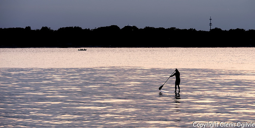 A lone paddle boarder on Lake Huron