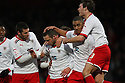 Chris Beardsley of Stevenage (2nd l) is mobbed after scoring their first goal. - Stevenage v Tranmere Rovers - npower League 1 - Lamex Stadium, Stevenage - 17th December 2011  .© Kevin Coleman 2011 ... ....  ...  . .