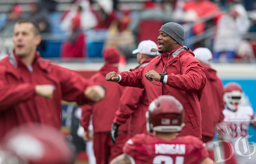 NWA Democrat-Gazette/BEN GOFF @NWABENGOFF<br /> Trumain Carroll, Arkansas strength and conditioning coach, during warm ups Saturday, April 7, 2018, during the Arkansas Red versus White Game at War Memorial Stadium in Little Rock.